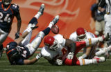 Denver Broncos John Lynch, left, recovers a fumble by Kansas City Chiefs Larry Johnson in the...