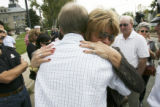 Dan Dietz Sr,. father of deceased, back to camera, receives an emotional hug from his sister,...