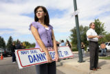 Tiffany Bitz, (cq), 23, sister of the deceased, holds a pair of extra donated signs in the street...
