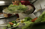 Armando Botello, CQ, a cook, prepares house salads without spinich at Bambino's at 1135 Bannok  in...