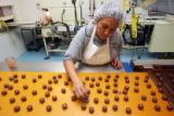 Angeles Dominguez (cq), does streaming on all-milk truffles while manufacturing chocolates at...