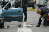 A plain clothes Aurora Police officer was shot in killed in his car as he stopped at the...