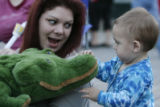 DLM04132   Lori Hayhurst, 33, of Denver, shows off her stuffed crocidile to one-year-old Jonah...