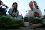 DLM04313   Lili Hayhurst, 5, right, of Denver sits next to her stuffed crocodile as she and her...