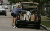 Lisa Olsen (cq) of Denver loads another bag into her car of bags bought mostly from Target in...