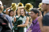 Colorado State University cheerleader Nicole Prentice (cq, center) a 20 year-old junior at the...
