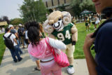 CAM the Ram, the Colorado State University mascot, tries to dance with Mikyla Nelson (cq, center...