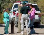 A Mesa County Citizen on Patrol  member answers questions from friends of a 22 yr old man who...