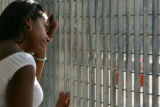 9/11 story.   Kimberly Best (cq), of Los Angeles, looks through the fence at the perimeter of...