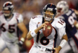 The Denver Broncos quarterback Jake Plummer scrambles for a first down againt the New England...