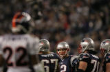 (JPM1102) - New England Patriots quarterback Tom Brady looks past his lineman at the Denver...