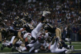 JPM024 Denver Broncos runningback Mike Bell leaps over the goal line in the closing moments of the...