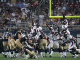 JPM729 St. Louis Rams kicker Jeff Wilkins scores with a 26- yard field goal agains the Denver...