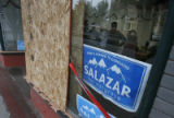 Workers at John Salazar's campaign headquarters pause behind a boarded up window in Pueblo, Colo....