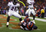 The Denver Broncos' Rod Smith (#80, WR) hauls in a touchdown pass in the corner of the endzone as...