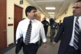 Pete Zenner (cq), left, an investigator for the Colorado Public Defenders office, exits  Douglas...