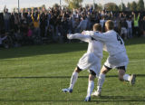 Arapahoe's #11, Ryan Taylor, and #4, Chris Carry, celebrate after Taylor scored the second goal in...
