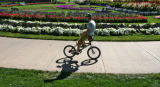 Justin Clemens (cq) rides his bike backwards through Civic Center Park Tuesday afternoon Spetember...
