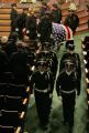 An Honor Guard and Pall bearers from the Aurora Police department carries the casket of slain...