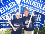 Dottie, left, and Roy Knoedler hold campaign signs for their son, Matt Knoedler, who is running...