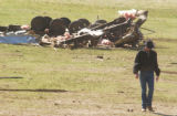 Elbert County, Colo.-May 11, 2004- Herman Stuke walks away from where part of his mobile home was...