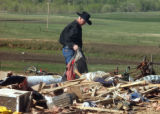 Elbert County, Colo.-May 11, 2004 Herman Stuke piks through his personal belongings on Tuesday...