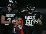 (JPM116) -  Limon Badger Zach Scherrer, #80, takes a kickoff return in for a first quarter...