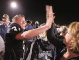 (JPM607) -  Limon Badger Iassac Ashcraft, left, high fives Brenda Liggett (cq) after Limon beat...