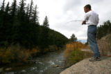 DLM01454   Brent Johnson, 28, of Denver fishes on the South Platte River just down stream from...