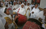 Woman join in dance and song that was part of an Ethiopian service Sunday morning October 1, 2006...
