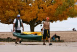 Bob Loehrs (cq), left and his son A.J. Loehrs, 13 years old, carry their kayaks back to their car...