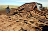 Elbert County, Colo.-May 11, 2004- Herman Stuke walks past his barn on Tuesday (5-1-04). The...
