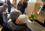 Janet O'Halloran, cq, left, hugs Sister Cecily Jones, cq, before a prayer service for Sister Mary...