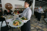 Hana Kim (cq), left, and other servers from Palettes restaurant wait a moment to deliver plates of...