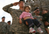 MJM087 2nd Brigade Army Specialist, Christopher Taylor (cq), left, salutes as he holds Zoe...