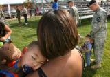 MJM157 Jessica Williams (cq) holds her sleeping son, Jacob Bejararo, 1,  while her brother in law,...