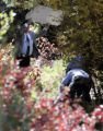 Investigators take photos of an area along the roadside at mile marker 220 on 285 between the...