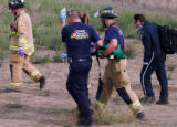 Union Colony Fire Authorities rush a infant into the flight for life helicopter for transport...