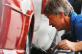 (DENVER, Colo., July 20, 2004)   Maurice Sonek, an employee of Hadley Auto Transport examines a...