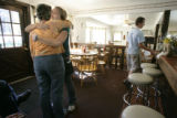 Bethany Rosentrater, CQ, 19, second from left, hugs Cutthroat Cafe owner Renie Thomas, CQ,  after...