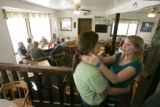 Bethany Rosentrater, CQ, 19, right, hugs Cutthroat Cafe manager Bobbie Sterling, CQ, after her...