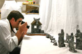 Photographer Rob Jones (cq) takes photos of a pewter nativity scene, by sculptor Michael Ricker,...
