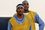Newly acquired guard J.R. Smith left, with teammate Carmelo Anthony, right, while Smith attended...