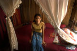 Kampong Thom, Cambodia.  November 12, 2003.   Srey Oun Sim, 24, sits on her bed in her brothel in...
