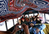 A photo is taken of a tour tour group on Banjo Billy's Bus  in Boulder, Colo., Friday night Oct....