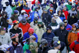 Skiiers and boarders wait in line at Arapahoe Basin Ski Area early Friday October 13, 2006 hoping...