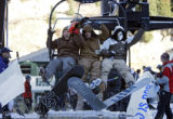 Catching the first chair up the mountain at Arapahoe Basin on the Exhibition lift was (left to...