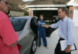 (JPM091) - John Andrews, former president of the Colorado Senate, right, shakes hands with Joanne...