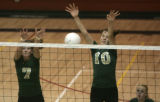 (5A) Mountain Vista Golden Eagles #7 Kate Gerfen, left, and #10 Ariel Turner, right, can't stop a...