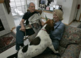 Bob Beauprez watches as Petey (their sons dog) tries to get Claudia's attention while sitting in...